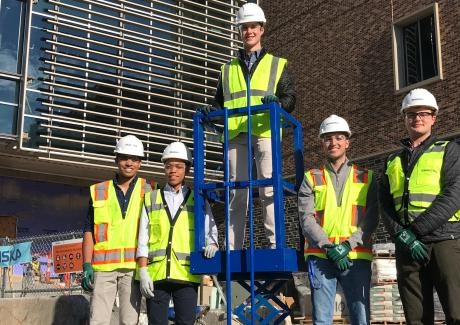 students at new building site