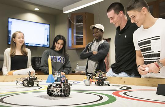 undergrad students compete in Robot Olympics